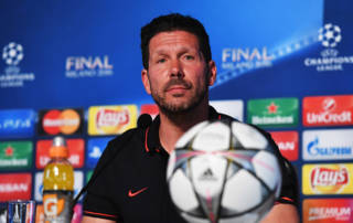 MILAN, ITALY - MAY 27:  In this handout image provided by UEFA Head coach Diego Simeone of Atletico Madrid talks to the media during a Atletico de Madrid press conference on the eve of the UEFA Champions League Final against Real Madrid at Stadio Giuseppe Meazza on May 27, 2016 in Milan, Italy.  (Photo by Handout/UEFA via Getty Images)